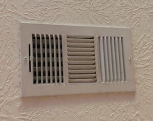 Air vents restrict air movement and must be sealed to prevent air from being forced into the attic.