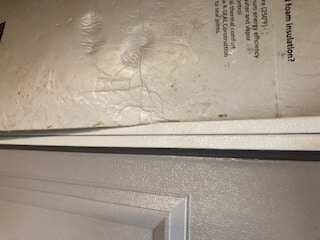You will need to bend the foam insulation board to get it into the lip of the garage door panel.