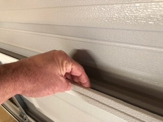 Garage door panel lip provides a way to mount foam insulation panels