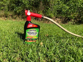 Spectracide Triazicide concentrate connects directly to garden hose to ensure proper mixing during use.