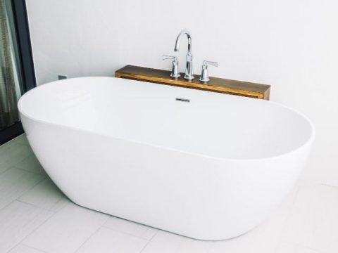 Installing a tub over tile requires consideration of the subfloor, plumbing, appropriate leveling, and potential tile damage.