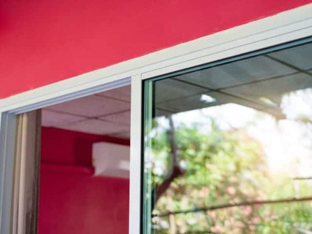 Why a sliding glass door rattles in the wind and how to solve it.