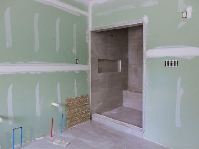 Building code requirements for using green board drywall.